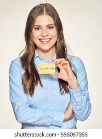 Smiling woman holding credit card. Business woman isolated portrait.