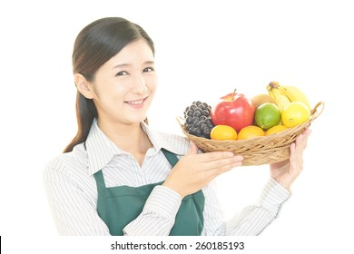 Smiling woman holding fruits