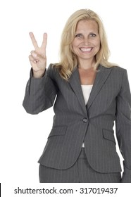 Smiling woman holding up her fingers in a V symbol.