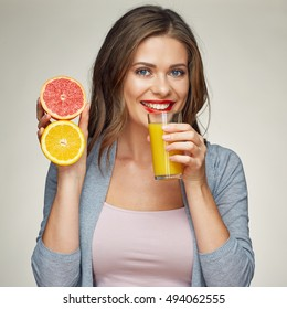 smiling woman holding juice glass with half orange and grapefruit. isolated studio portrait.