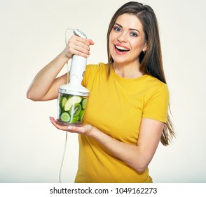 Smiling woman holding kitchen blender with kiwi and cucumber for smoothie detox fresh. Isolated portrait.