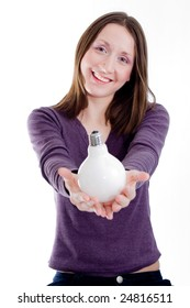 Smiling woman, holding lamp in hand on white background