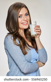 Smiling woman holding milk glass. Isolated female portrait.
