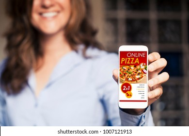 Smiling woman holding a mobile phone with pizza shopping app in