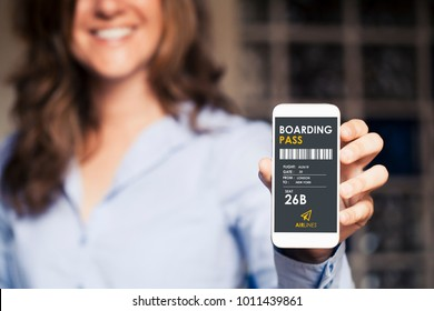 Smiling woman holding a mobile phone with electronic boarding pass in the screen.