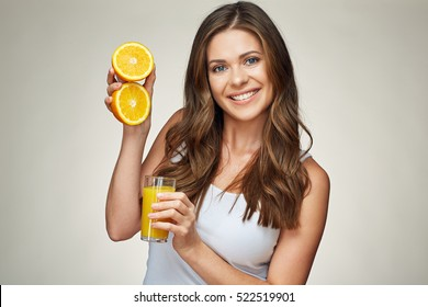 smiling woman holding orange juice and fruit. vitamin drink. isolated portrait.