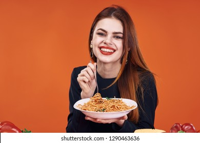 smiling woman holding a plate of spaghetti italy pasta