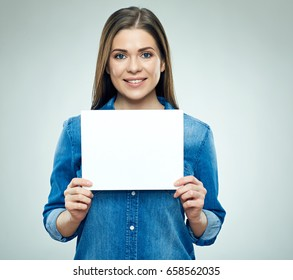 Smiling woman holding sign board. Isolated studio portrait.