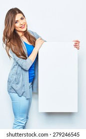 Smiling woman holding signboard. Female model hold white blank business card.