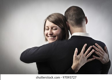 Smiling woman hugging her husband