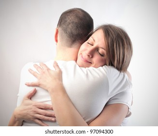 Smiling woman hugging her husband