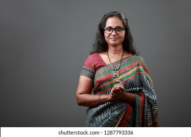 Smiling woman of Indian origin wearing sari