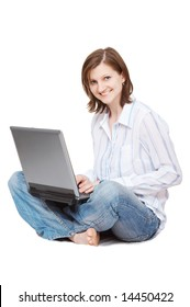smiling woman with laptop sitting on the floor