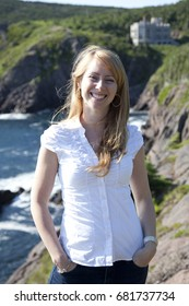 A smiling woman in Logie Bay in Newfoundland in Canada.