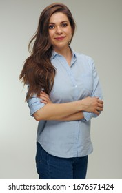 Smiling woman with long hair wearing blue shirt. Isolated studio female portrait.