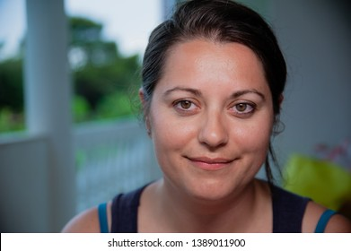 smiling woman looks into camera, ordinary person, close up