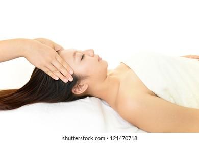 Smiling woman at massage spa