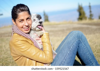 smiling woman  in the mountain with her dog