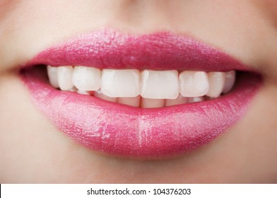 smiling woman mouth on background