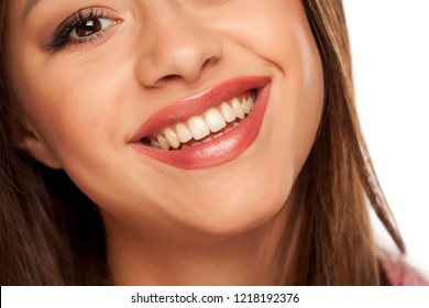 Smiling woman with natural and healthy teeth