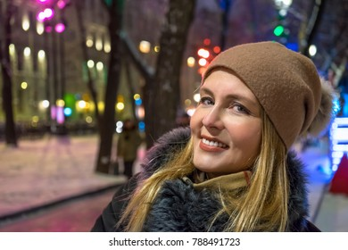 Smiling woman at the night city