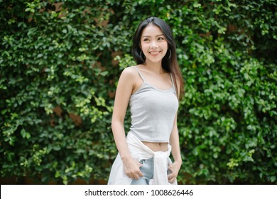 Smiling woman on green Leaf background
