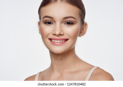 Smiling woman on a light background