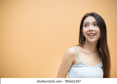 Smiling woman on orange background