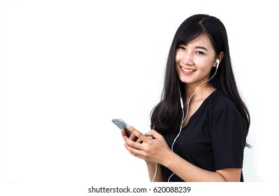 Smiling woman playing smartphone standing on white background.