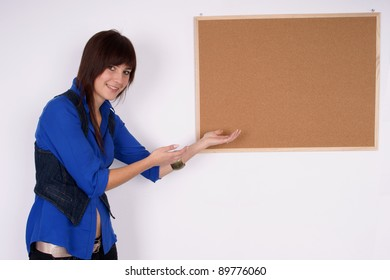 Smiling woman pointing at the board.
