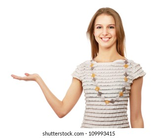 A smiling woman pointing and looking up, isolated on white