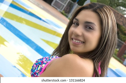 smiling woman at the pool