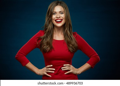 smiling woman portrait. girl wearing red dress. blue background.