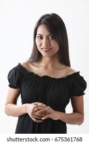 Smiling woman posing for the camera in a studio