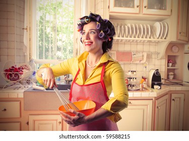Smiling woman preparing food in a kitchen
