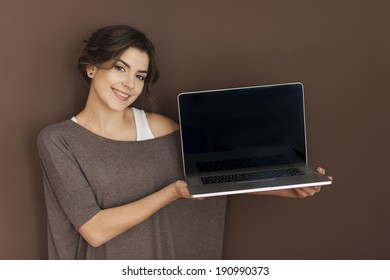 Smiling woman presenting contemporary laptop