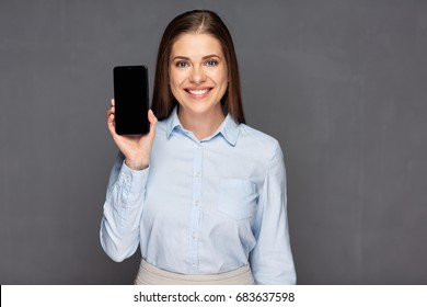 Smiling woman presenting smart phone with empty screen. Smile with teeth.