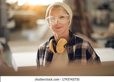 Smiling woman in protective eyewear - Shutterstock ID 1793743735