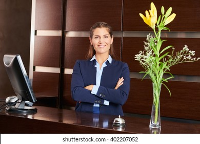 Smiling woman as receptionist in a hotel lobby