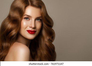 Smiling Woman with Red Curly Hair. Perfect Redhead Model, Pretty Face on Background with Copy space