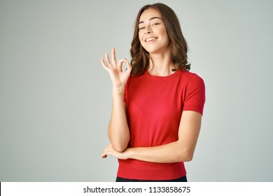 smiling woman in a red t-shirt