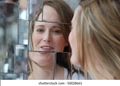 smiling woman with reflection in mirrors