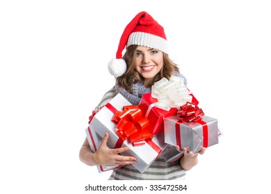 Smiling woman in santa helper hat with many gift boxes on white background.