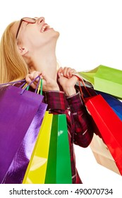 Smiling woman with a lot of shopping bags