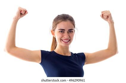 Smiling woman showing biceps