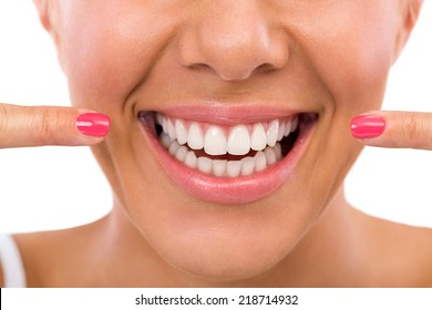 Smiling woman showing her perfect white teeth