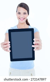 Smiling woman showing her tablet looking at camera on white background