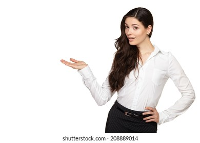 Smiling woman showing open hand palm with copy space for product or text