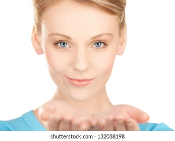 smiling woman showing something on the palms of her hands