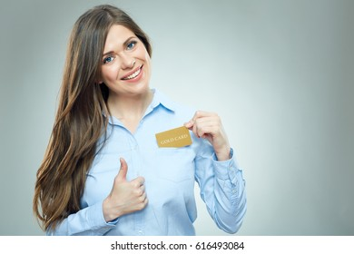 Smiling woman showing thumb up gets out credit card from pocket. Isolated portrait.